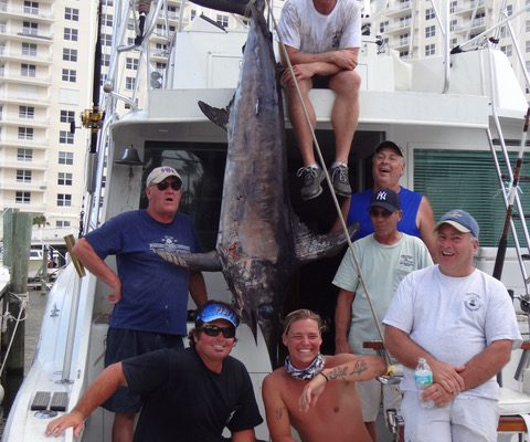 Capt Adam, Ryan and Tyler and some happy anglers with 300 lb Swordfish caught by New Lattitude Sportfishing Charters