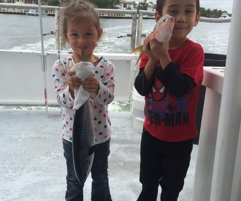 Some cute kids with some cute fish caught on the Catch My Drift