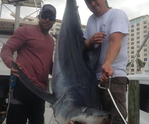 Adam and Bobby with a monster mako shark caught with New Lattitude Sportfishing