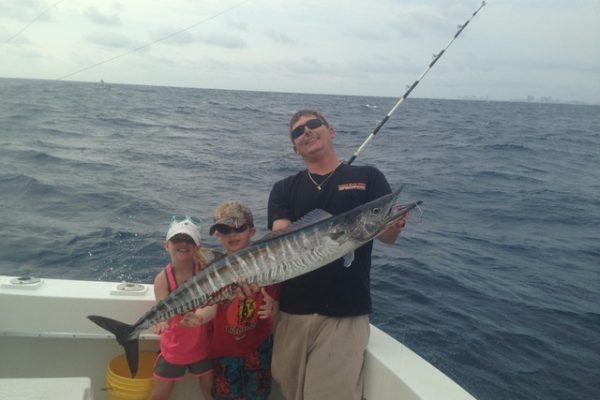 Capt Rod with a nice wahoo caught by these kids sportfishing with