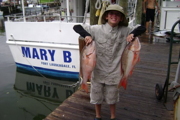 This young angler caught 2 big mutton snappers- Nice fish kid!